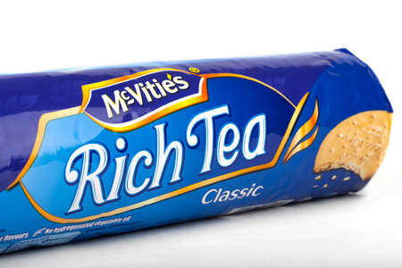 tea and biscuits: LONDON, UK - JUNE 16TH 2016: A packet of Original McVities Rich Tea Biscuits, on 16th June 2016.  McVities is a brand of British snack food and is owned by United Biscuits.
