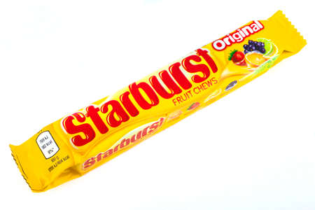 mars incorporated: LONDON, UK - JUNE 16TH 2016: An unopened pack of Starburst Fruit Chews, pictured over a plain white background on 16th June 2016.  The Chews are manufactured by Quadir company, a subsidiary of Mars, Incorporated.