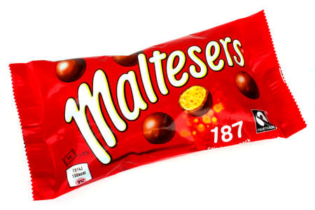 mars incorporated: LONDON, UK - JUNE 16TH 2016: A pack of Maltesers over a plain white background, on 16th June 2016.  Maltesers are a confectionery product manufactured by Mars, Incorporated.