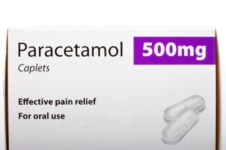 medicated: LONDON, UK - JUNE 16TH 2016: A packet of Paracetamol 500mg Caplets over a plain white background, on 16th June 2016. Editorial