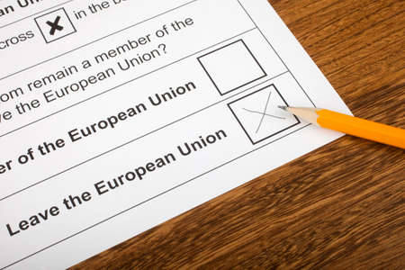 common market: LONDON, UK - JUNE 13TH 2016: The EU Referendum Ballot Paper, with a cross next to the option for the UK to Leave the European Union, taken on 13th June 2016.