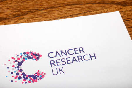 cancer research: LONDON, UK - JUNE 13TH 2016: A close-up of the Cancer Research UK logo on the top of a letter, taken in London on 13th June 2016.