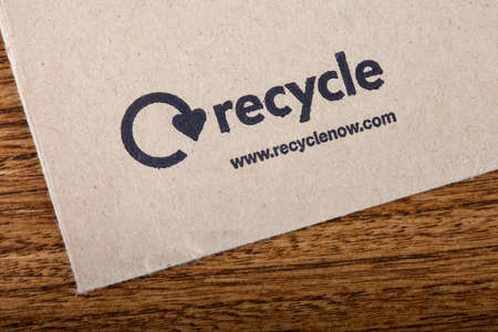 illustrative material: LONDON, UK - JUNE 13TH 2016: Close-up of the official Recycle Now symbol on the back of an envelope, taken in London on 13th June 2016. Recycle Now is a national recycling campaign funded by the government in England. Editorial