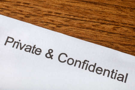 bureaucratic: Private and Confidential printed on a piece of paper.