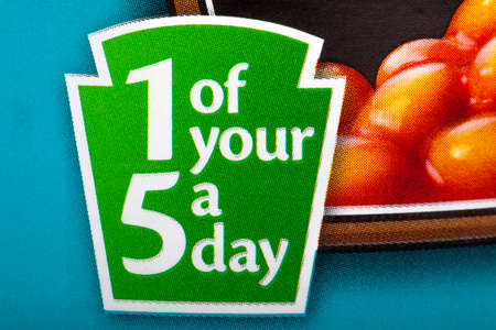 contain: LONDON, UK - MAY 6TH 2016: A close-up of a sign on a can of Heinz Baked Beans informing the consumer that the contents contain 1 of your recommended 5 fruit and vegetable portions a day, on 6th May 2016. Editorial
