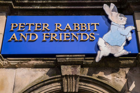 beatrix: CUMBRIA, UK - MAY 29TH 2016: A sign for the Peter Rabbit and Friends Gift Shop in Bowness-on-Windermere in the Lake District, on 29th May 2016.