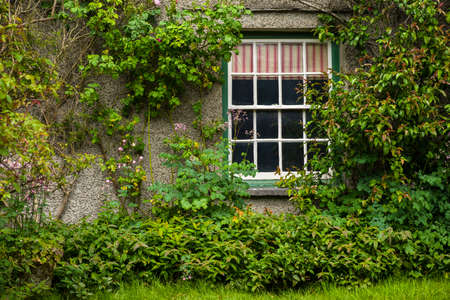 beatrix: CUMBRIA, UK - MAY 30TH 2016: A shot of Hill Top - a 17th Century House in the Lake District, once home to childrens author Beatrix Potter, taken on 30th May 2016. Editorial