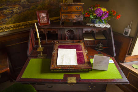 beatrix: CUMBRIA, UK - MAY 30TH 2016: Beatrix Potters writing desk at Hill Top - a 17th Century House once home to childrens author Beatrix Potter, taken on 30th May 2016. Editorial