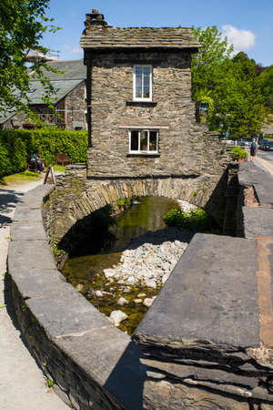31st: CUMBRIA, UK - MAY 31ST 2016: A view of the historic Bridge House in Ambleside, the Lake District, on 31st May 2016.