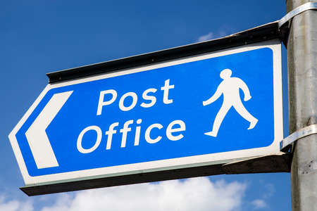 mailed: A sign showing the direction of the nearest Post Office in an English town.
