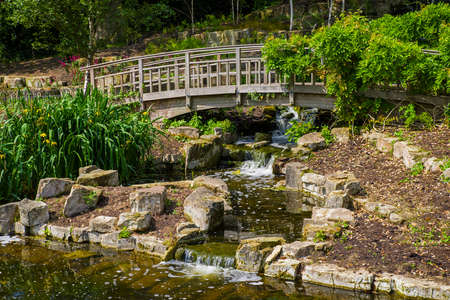 marys: A view of the beautiful Japanese Garden Island located in Queen Marys Gardens in Regents Park, London. Editorial