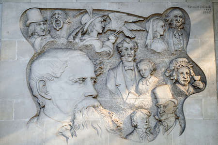 bas relief: A Bas Relief Carving on Marylebone Road in London, marking the location where Charles Dickens wrote six of his famous novels. Editorial