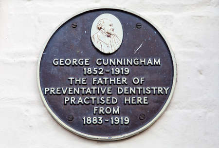 practised: A plaque marking the location where George Cunningham - the father of preventative dentistry practised in Cambridge, UK. Editorial