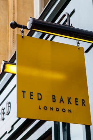 ted: CAMBRIDGESHIRE, UK - APRIL 8TH 2016: A sign for a Ted Baker fashion retail store in Cambridge, on 8th April 2016. Editorial