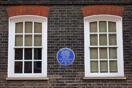 plaque: A blue plaque marking the location where iconic classical musician George Frideric Handel once lived in central London, England. Editorial