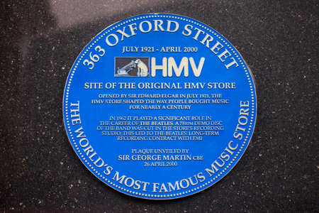 oxford street: A blue plaque marking the site of the original HMV music store on Oxford Street in London, England.