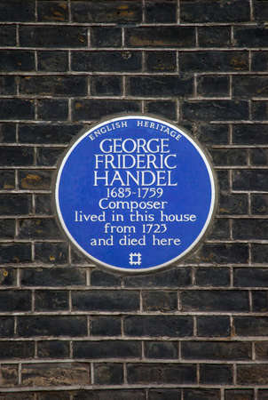 blue plaque: A blue plaque marking the location where iconic classical musician George Frideric Handel once lived in central London, England. Editorial