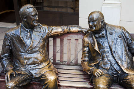 bond street: Statues of iconic wartime leaders Franklin D Roosevelt and Winston Churchill both sitting on a bench on Bond Street in London.