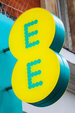 ee: LONDON, UK - APRIL 7TH 2016: The logo on the exterior of an EE retail store on Oxford Street in London, on 7th April 2016.