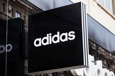 oxford street: LONDON, UK - APRIL 7TH 2016: A sign for an Adidas retail store on Oxford Street in London, on 7th April 2016. Editorial