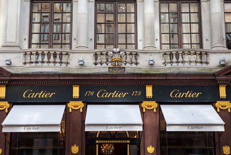 bond street: LONDON, UK - APRIL 7TH 2016: The exterior of the Cartier store on New Bond Street in Mayfair, London on 7th April 2016.