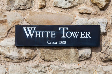 hamlets: A plaque marking the iconic White Tower at the Tower of London.  The tower was built by William the Conqueror during the 1080s.