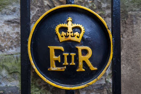 queen elizabeth: Queen Elizabeth II symbol on a gate at the Tower of London.