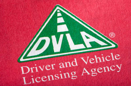 registering: LONDON, UK - APRIL 25TH 2016: The DVLA logo on an information booklet, on 25th April 2016.  DVLA stands for the Driver and Vehicle Licensing Agency and is responsible for maintaining a database of drivers and vehicles in the UK. Editorial