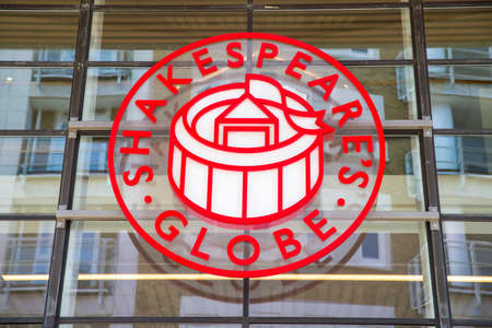 globe theatre: LONDON, UK - MAY 4TH 2016: The sign above the main entrance to Shakespeares Globe - the complex housing a reconstruction of the Globe Theatre in London, on 4th May 2016. Editorial
