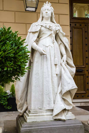 queen victoria: A statue of Queen Victoria situated on Carlton House Terrace in central London.