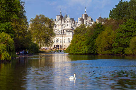 st james s: A view of the Horse Guards building over the lake in St. James's Park, London.