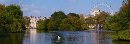 st james s: A beautiful panoramic view of St. James's Park in London with the Horse Guards building and London Eye in the background.