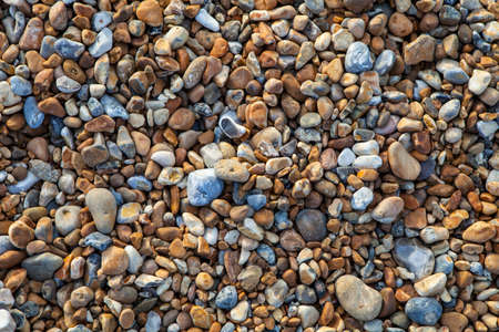 stoney: A close-up of the pebbled beach along the Hastings Seafront in Sussex.