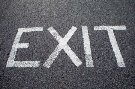 escaped: An EXIT marking on a road.