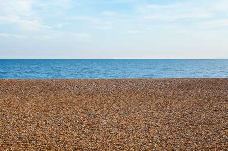 sussex: The pebbled beach and sea view at Hastings in Sussex.