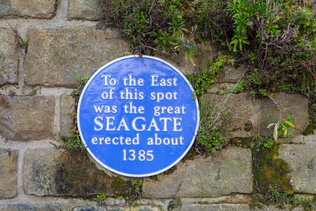 blue plaque: A blue plaque marking the location of the great western Seagate erected in about 1385 to block the old town of Hastings from the sea.