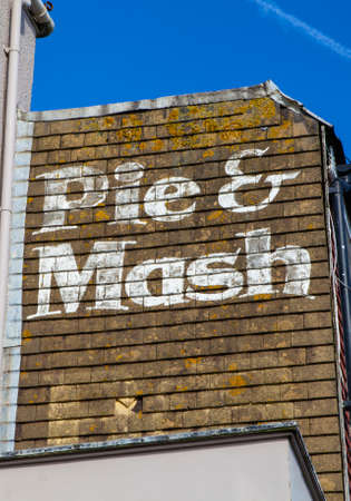 mash: An old-fashioned painted sign for a Pie and Mash shop in England. Editorial