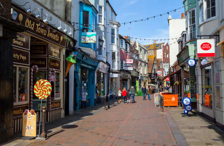 HASTINGS, UK - APRIL 1ST 2016: A view down George Street - one of the streets in the old town area of Hastings in Sussex, on 1st April 2016.