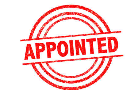 booked: APPOINTED Rubber Stamp over a white background. Stock Photo