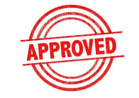 white backing: APPROVED Rubber Stamp over a white background.