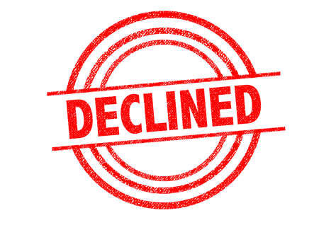 denying: DECLINED Rubber Stamp over a white background. Stock Photo