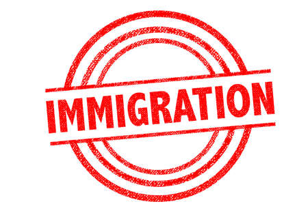 resettlement: IMMIGRATION Rubber Stamp over a white background. Stock Photo