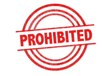 banning the symbol: PROHIBITED Rubber Stamp over a white background. Stock Photo