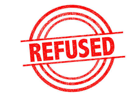 banning the symbol: REFUSED Rubber Stamp over a white background. Stock Photo