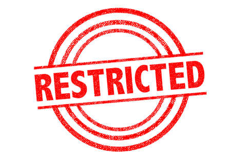 confinement: RESTRICTED Rubber Stamp over a white background. Stock Photo