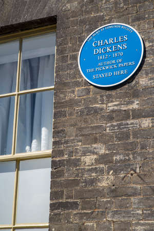dickens: A blue plaque at The Angel Hotel in Bury St. Edmunds marking the location where Charles Dickens stayed while giving readings in the nearby Athenaeum.