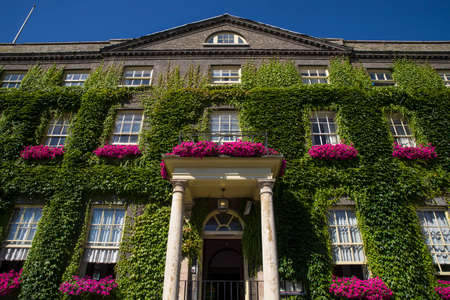 The impressive Georgian architecture of The Angel hotel in Bury St. Edmunds.  The hotel was used by Charles Dickens and was mentioned in The Pickwick Papers. Editorial