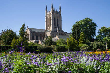 bury: A view of the beautiful flowers in Abbey Gardens and the historic St. Edmundsbury Cathedral in Bury St. Edmunds, Suffolk. Stock Photo