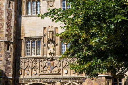gatehouse: A view of the King Henry VIII statue on the magnificent gatehouse of Trinity College in Cambridge, UK.  King Henry VII founded Trinity College in 1546.
