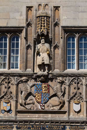 A view of the King Henry VIII statue on the magnificent gatehouse of Trinity College in Cambridge, UK.  King Henry VII founded Trinity College in 1546.